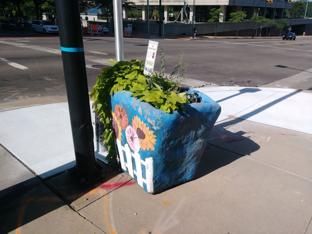 These one-of-a-kind planters are throughout the downtown. They are each individually painted with different themes.
