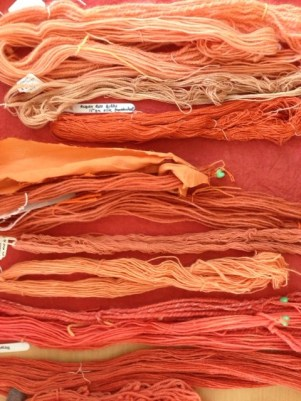 Turkey Red cotton (background) with various samples of madder-dyed wool and silk