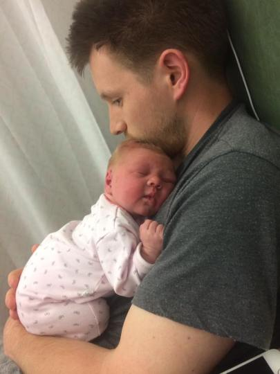 me holding Isabelle in the hospital. Luckily we've never actually had colic
