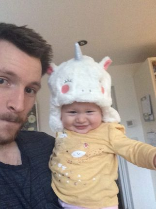 our baby wearing a unicorn hat during my week as a SAHD