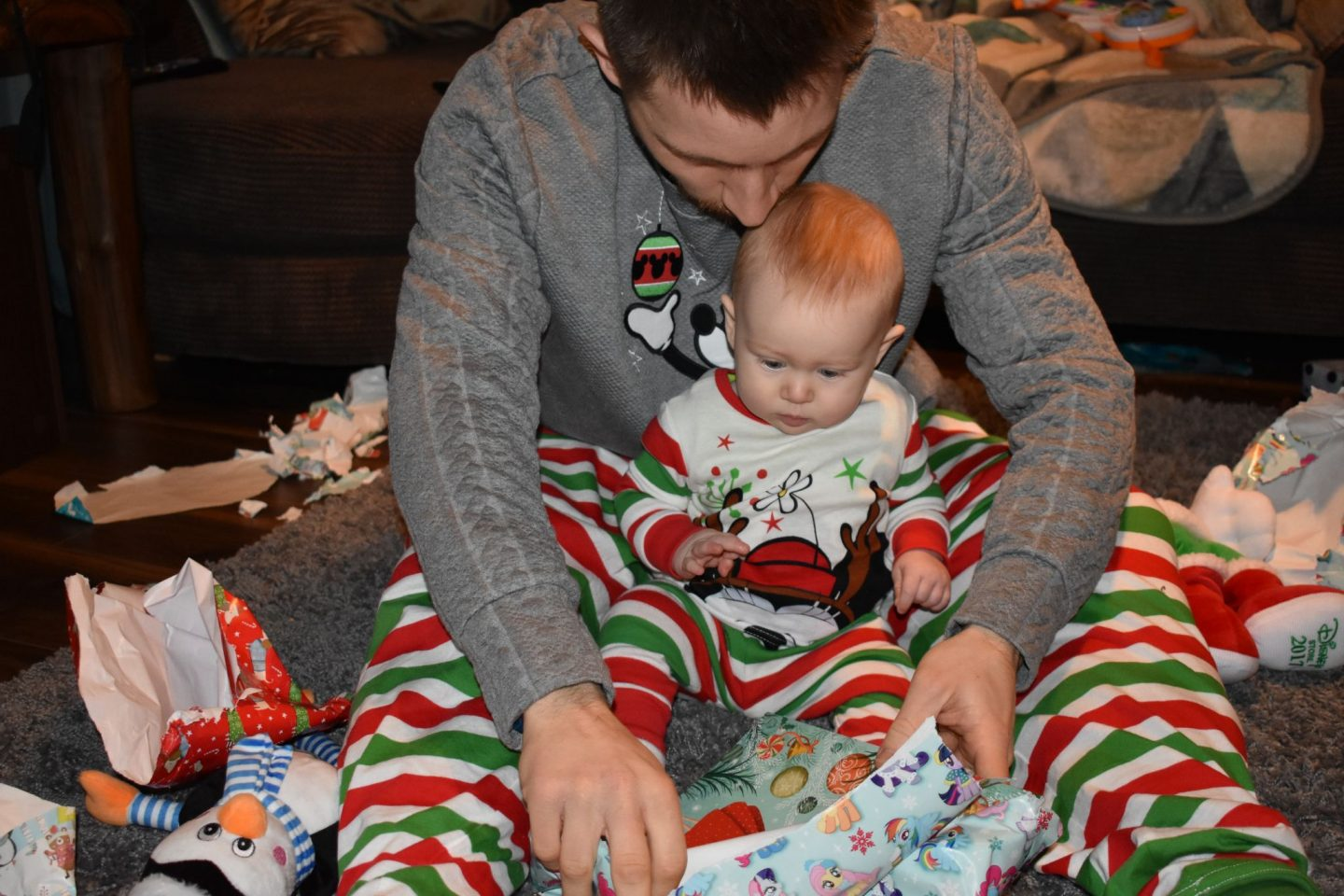 Opening presents with the baby on Christmas Morning