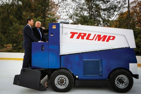 "Donald Trump, president and chief executive of Trump Organization Inc. and 2016 Republican presidential candidate, right, rides on an ice resurfacer during a Bloomberg Television interview with Mark Halperin, co-host of ""With All Due Respect,"" during an interview at Wollman Rink in Central Park in New York, U.S., on Monday, Nov. 2, 2015. Trump said being a businessman and fighting a war is ""all the same because it has to do with efficiency it has to do with common sense."" Photographer: Chris Goodney/Bloomberg via Getty Images"