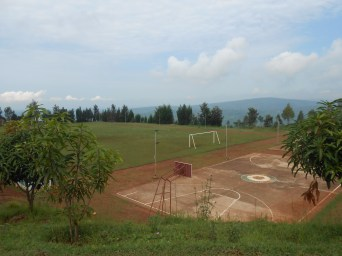 The basketball, volleyball, and football fields with the beautiful Rwandan backdrop.