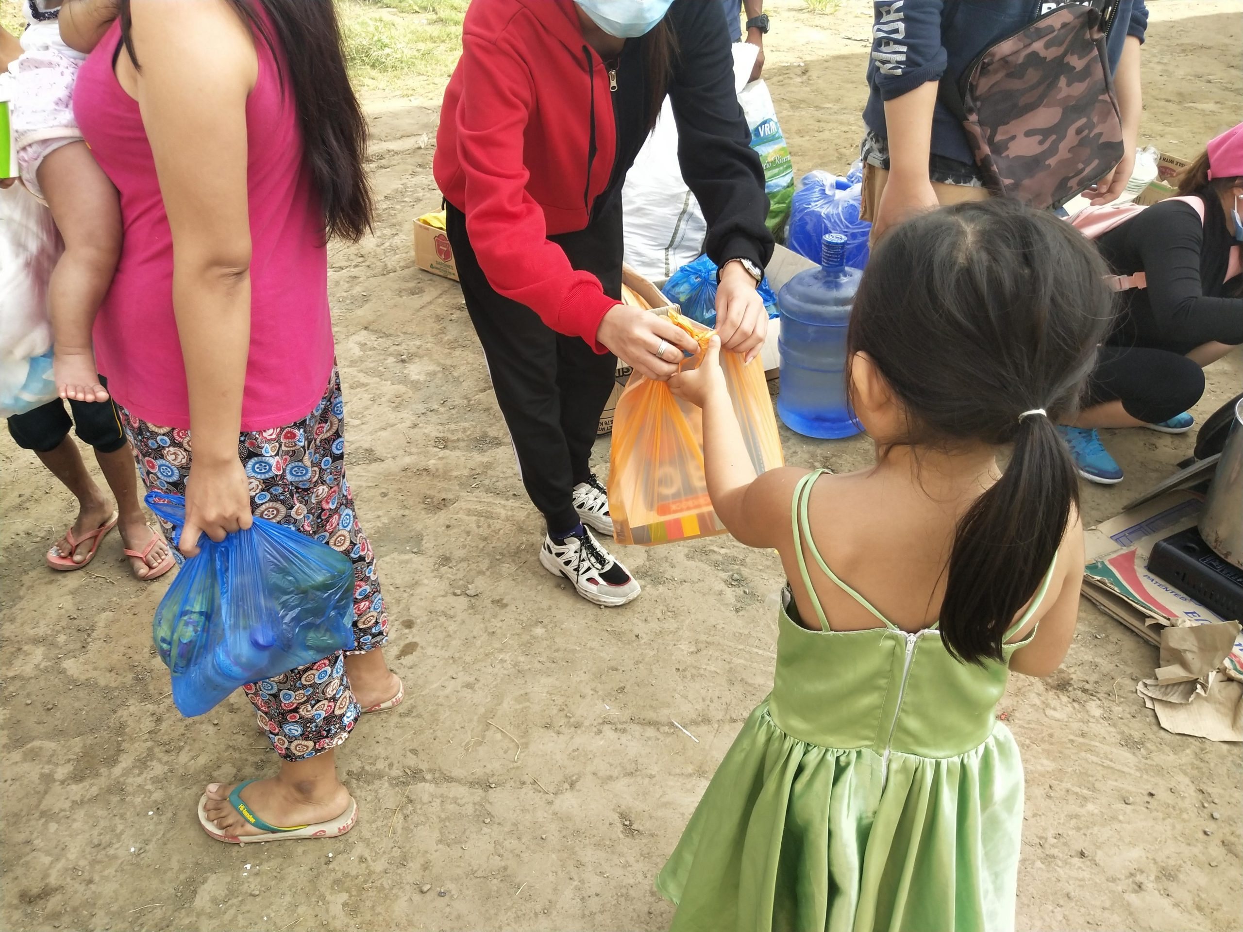 A child getting their own activity and supplement pack