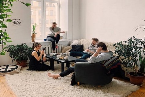 International students sitting and talking in an off-campus accommodation