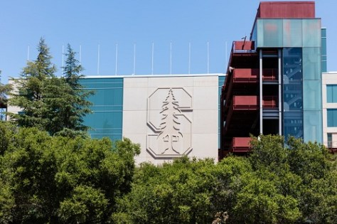 Stanford University campus building with logo