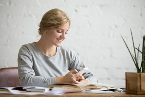 Girl checking reminders from a chatbot in higher education