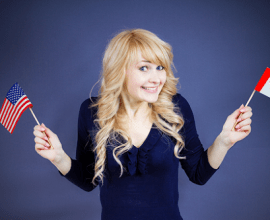 Smiling happy girl holding Flags of USA and Flag of Canada