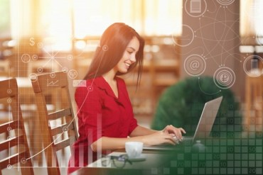 Woman smiling and typing on the laptop, pursuing a career in computer science