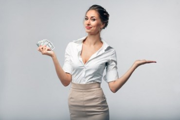 Corporate woman holding money telling you about the Highest paying jobs in the world