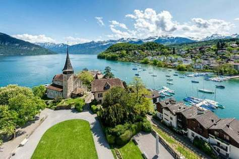 Spiez castle with cruise ship on lake Thun in Bern, Switzerland.