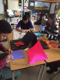 Students make origami models of Hyperbolic Paraboloids!