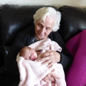 grandmother holding infant