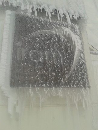 iram sign covered in icicles