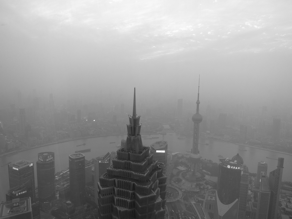 foggy black and white view of sky scrapers