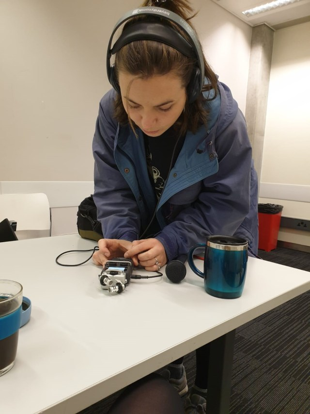 Lydia Melville with a zoom recorder