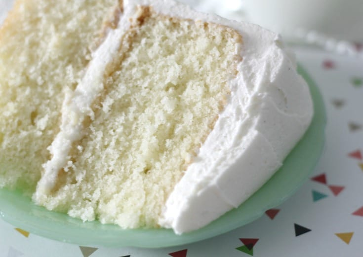 vanilla cake slice on light green plate