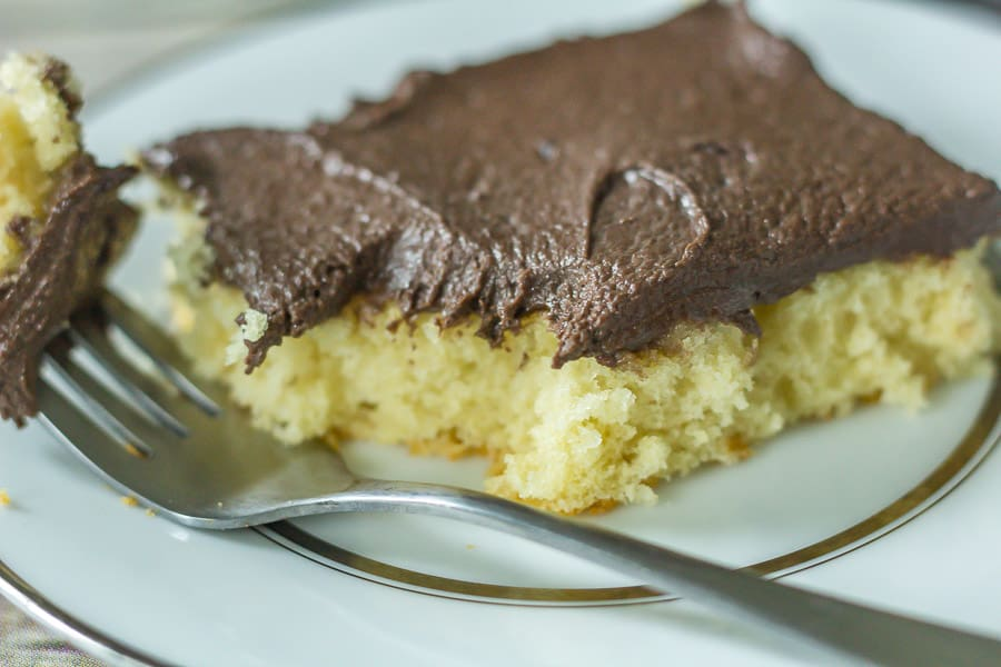 Yellow Buttermilk Sheet Cake on a plate with a fork