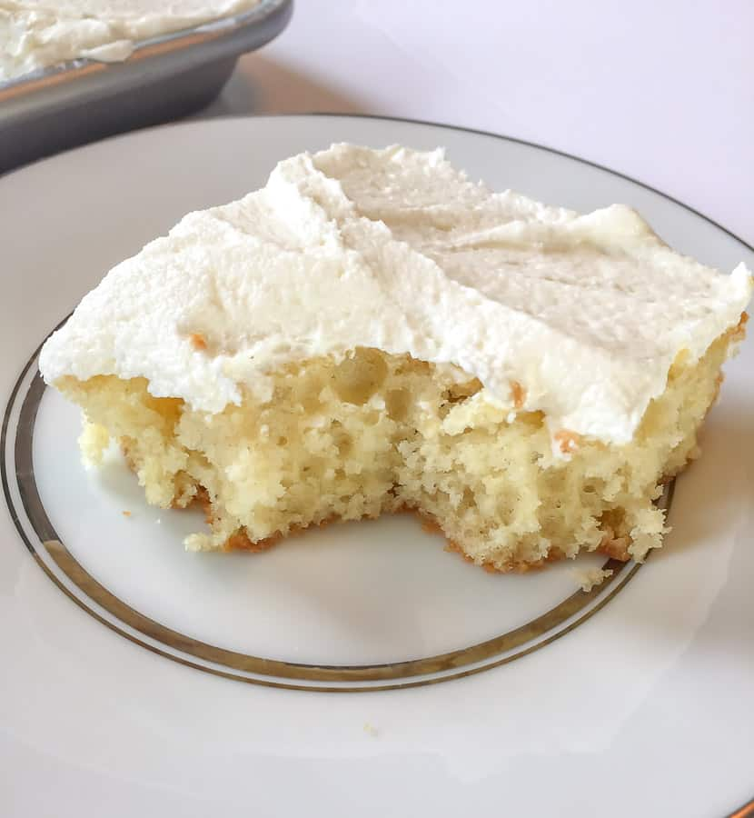 Yellow Buttermilk Sheet Cake with white chocolate buttercream on a white plate