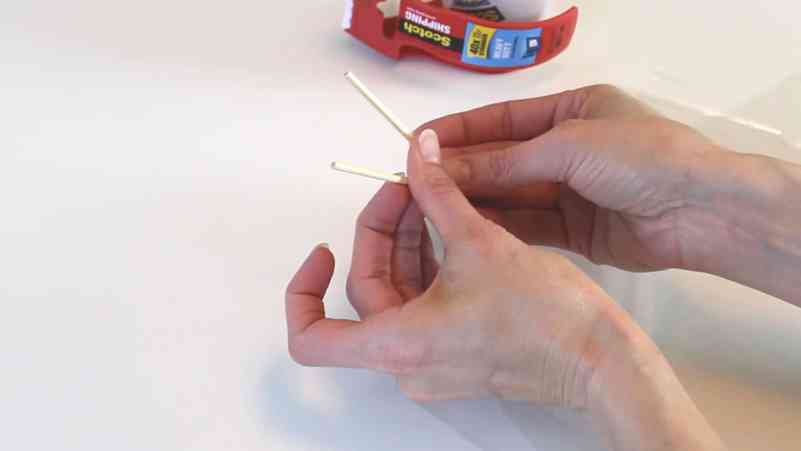Using small wooden dowels for peppermint candy cake