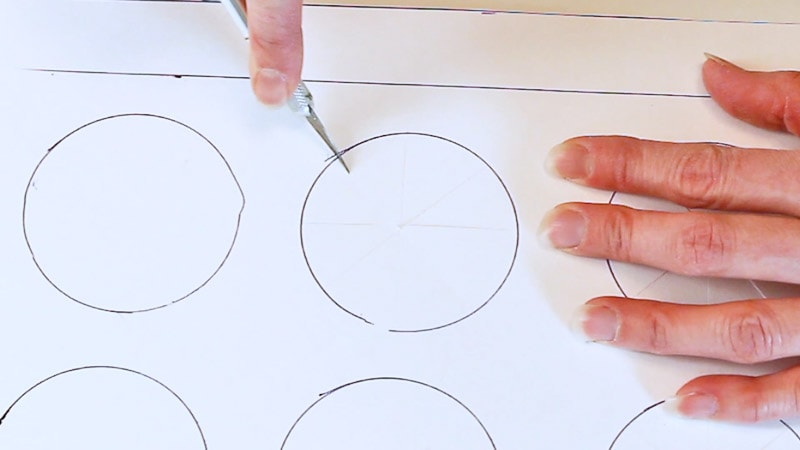 cut slits into the circles for the cupcake box inserts