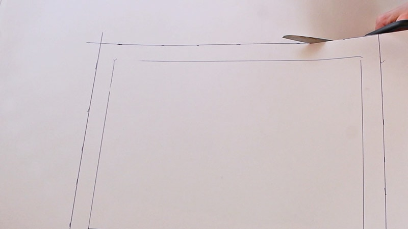 cutting around the outside line that was traced on cupcake insert box