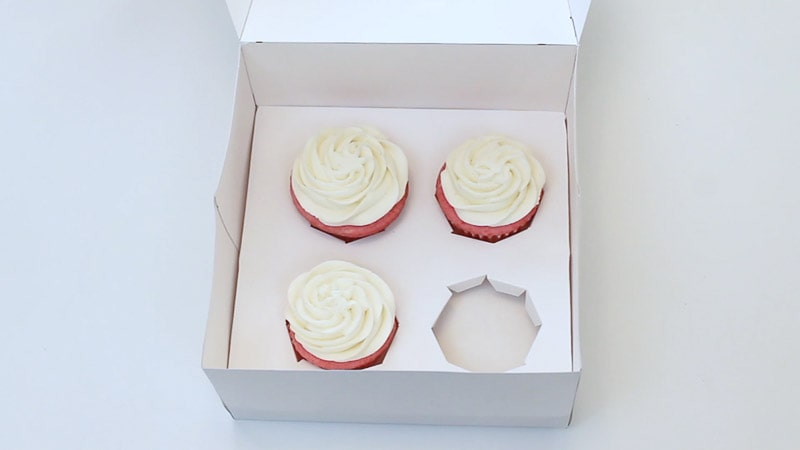 adding cupcake liners to the DIY treat boxes
