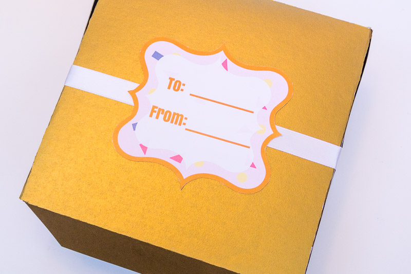 gold treat box with label