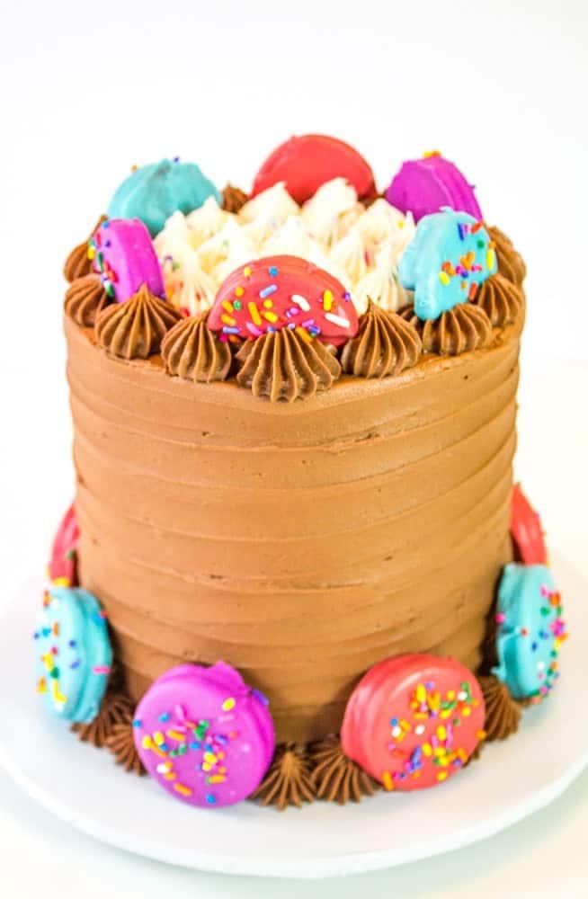 oreo insanity cake with candy dipped oreos