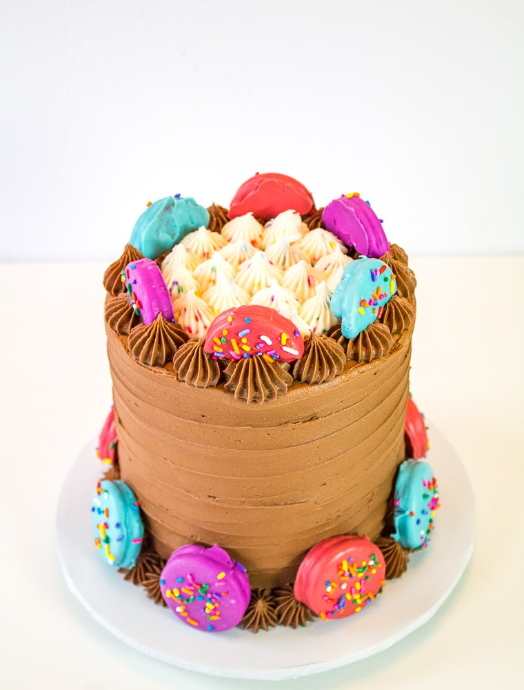 oreo insanity cake with colorful oreos attached