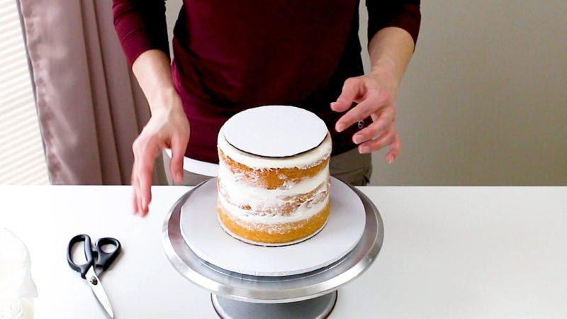 set cake board onto bottom cake tier