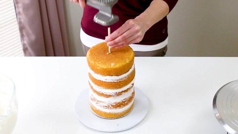 Hammer in center dowel into cake