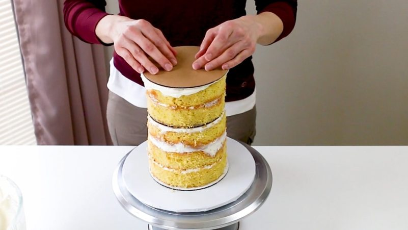 Add the top board to the cake