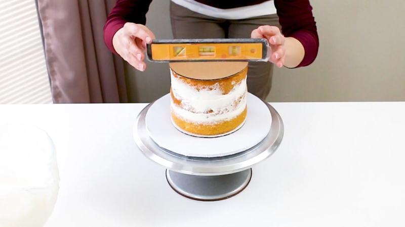 cake with board and level on top