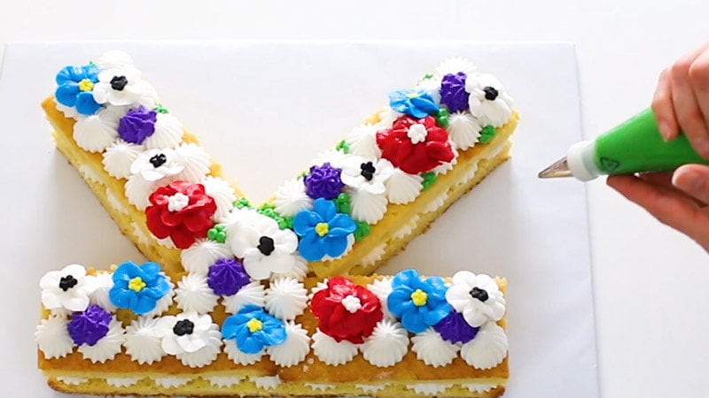 Add buttercream berries to initial cake