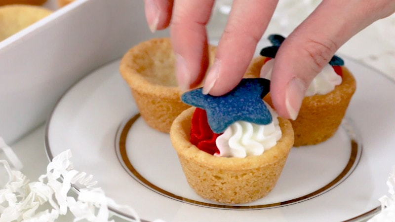 Adding star to patriotic cookie cups