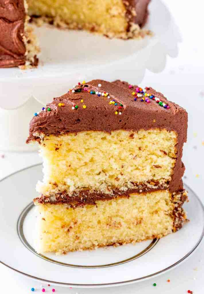 Classic Yellow Cake with Fudge Frosting on a white plate