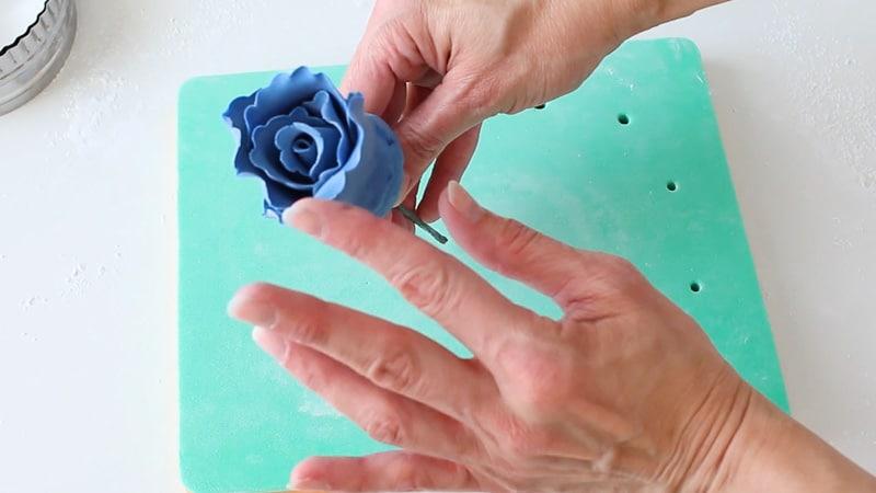 Attach gumpaste petal to ruffle rose