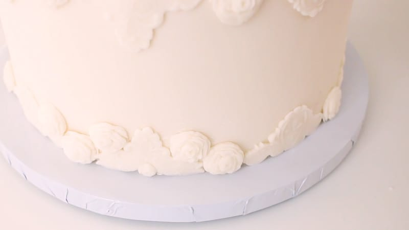 add the fondant roses to the bas relief cake