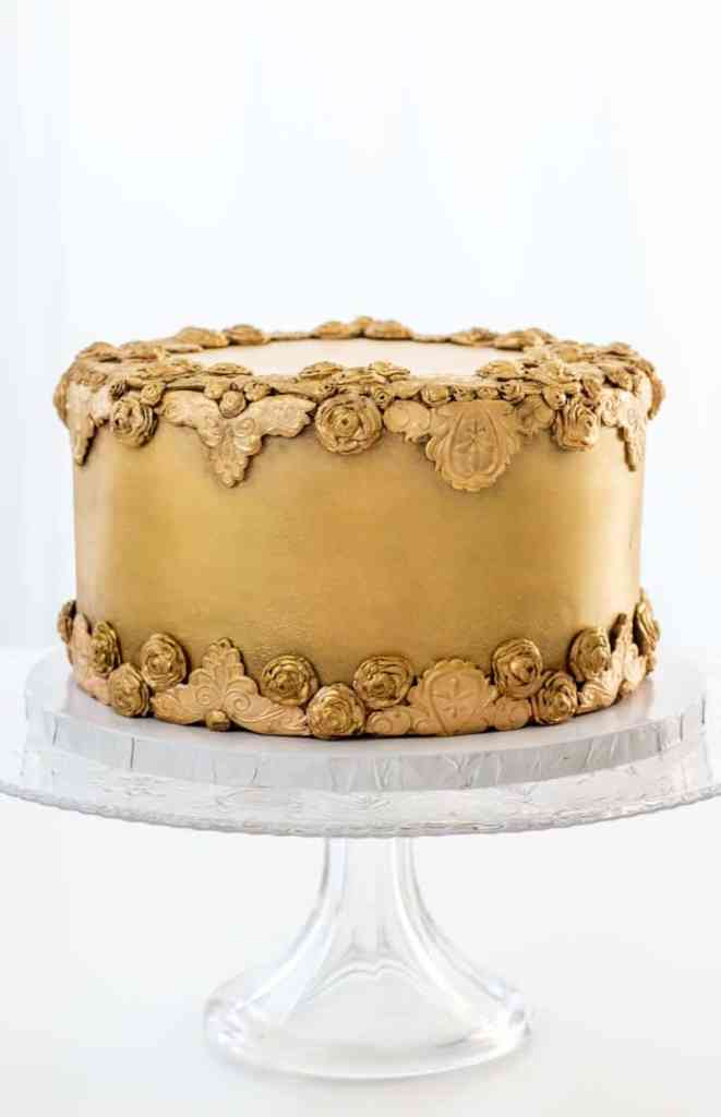 Antiqued Bas Relief Cake on a cake stand