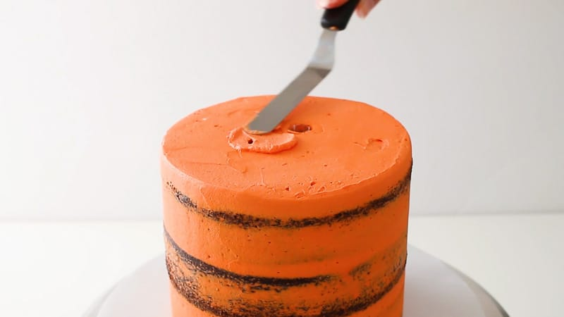 smooth buttercream over the dowels