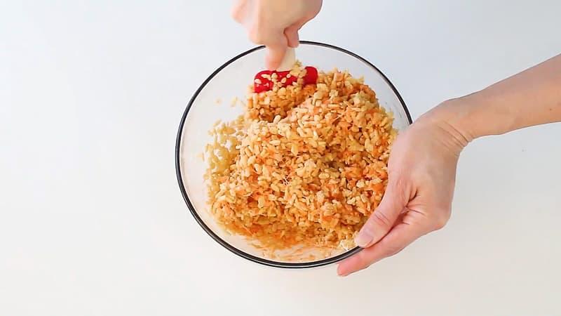 mixing orange rice krispie treats