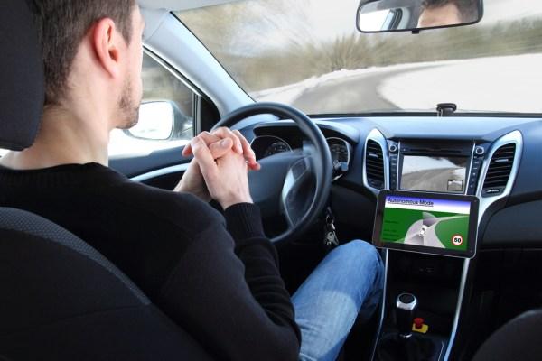 A man in a Autonomous vehicle