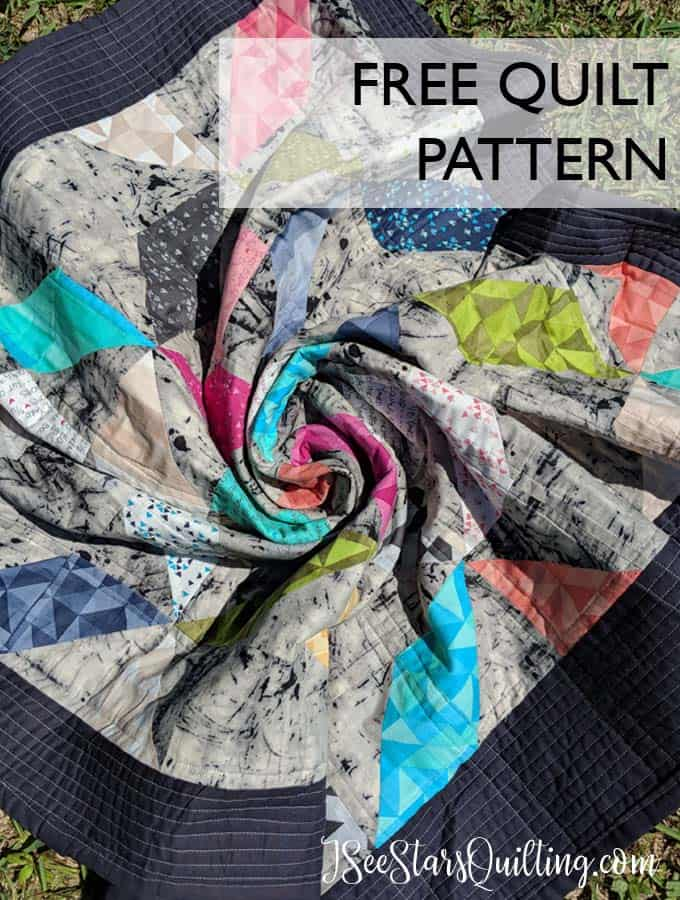 This super colorful quilt pattern is a free download! Windy Days by www.iseestarsquilting.com