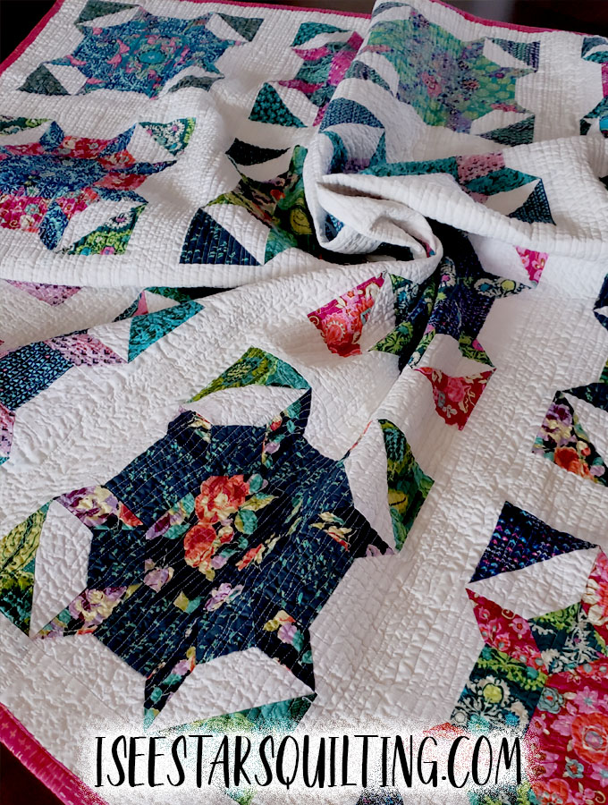 """Here are the pictures of a quilting project I made using the pattern called """"Shimmer"""". Including photos of fabrics and final products."""
