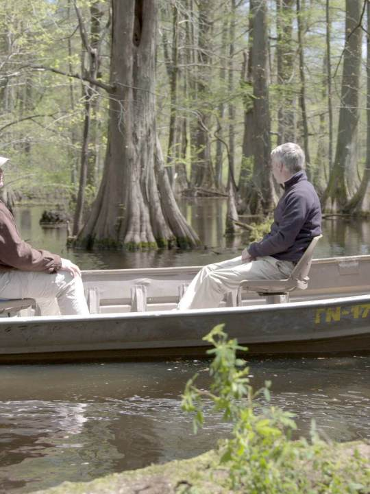 Stuart Burgess and Del Tackett in a boat on Reelfoot Lake