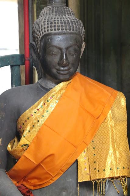 Buddha image at shrine inside Banteay Kdei