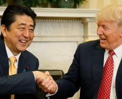Japanese Prime Minister Shinzo Abe shakes hands with U.S. President Donald Trump (R) during their meeting in the Oval Office at the White House in Washington - RTX30HU8