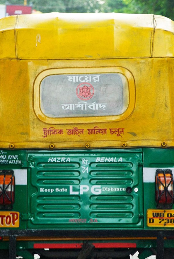 'Mother's Blessings' written on the back of an Auto in Kolkata