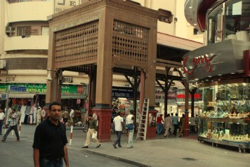 Traditional wooden frames the entrance to the Gold Souq